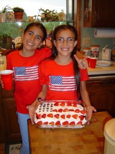 Fran and Amanda, now all grown up, with the cake they made!